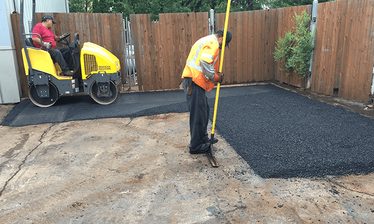 workers checking asphalt