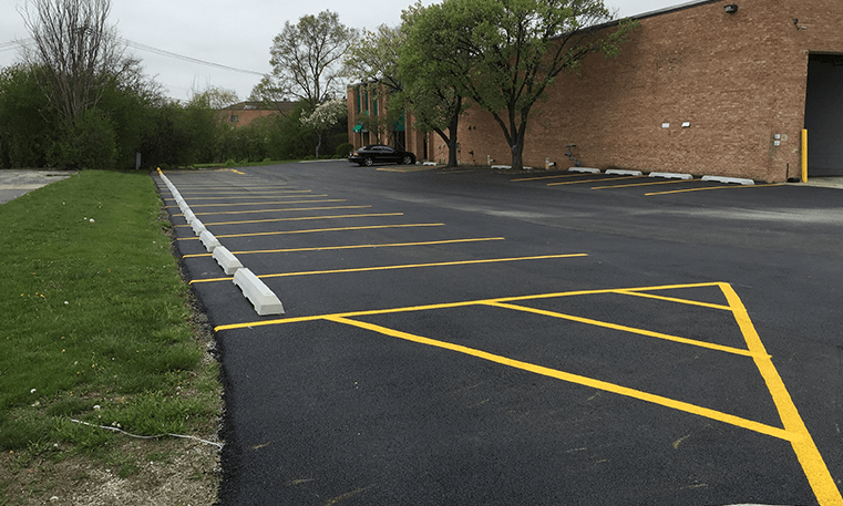 new asphalt and parking lot markings