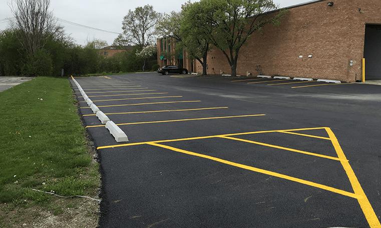 new asphalt and parking lot markings