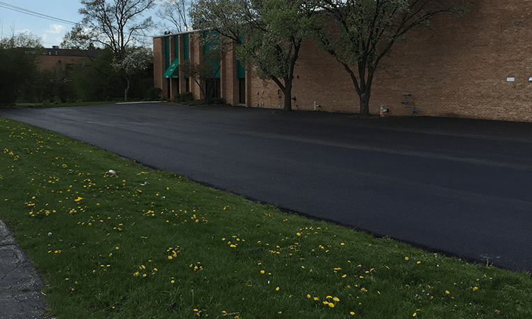 new asphalt overlay parking lot