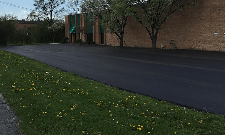 new asphalt overlay parking lot