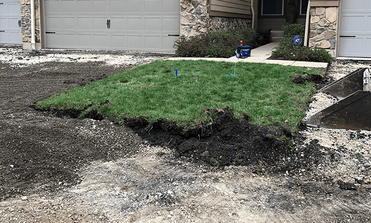 removing asphalt around grass