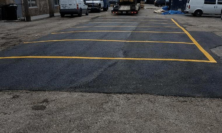 asphalt repaired parking lot