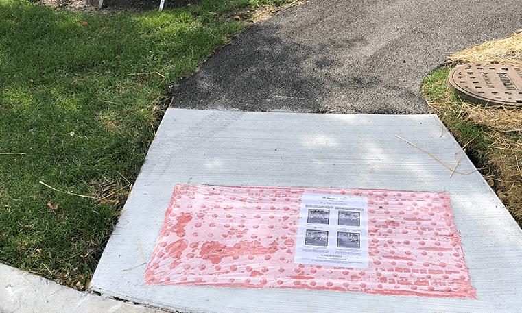 concrete and asphalt sidewalk