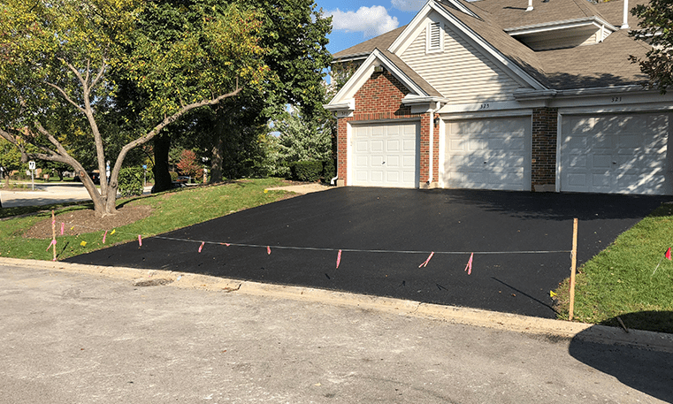 asphalt driveway in front of house