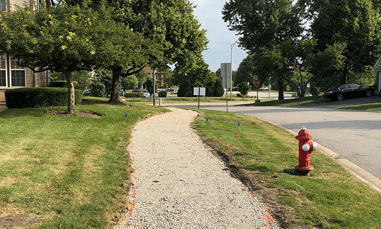 sidewalk before asphalt