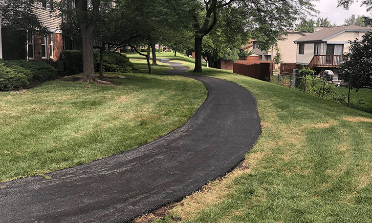 asphalt sidewalk in neighborhood