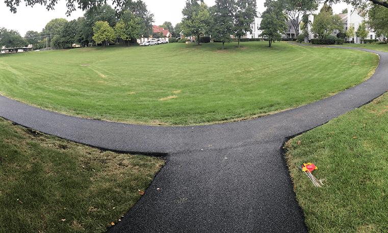 asphalt turn on sidewalk