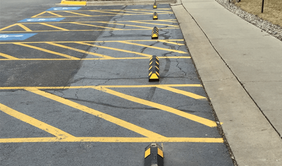 row of bumper blocks in parking lot