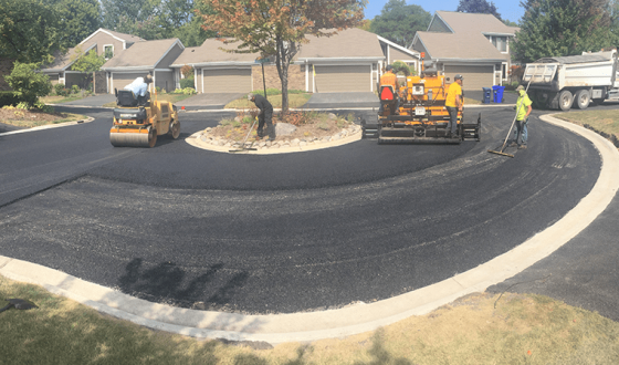 construction crew paving neighborhood street