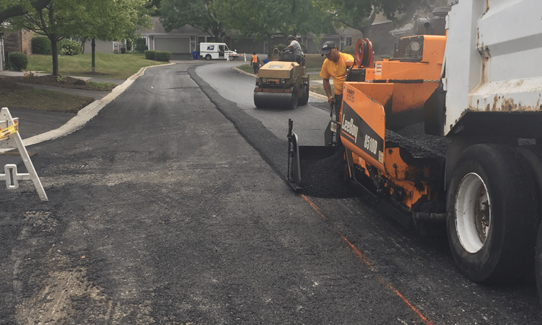 construction workers paving street