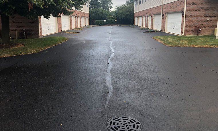 completed asphalt driveway in front of townhomes