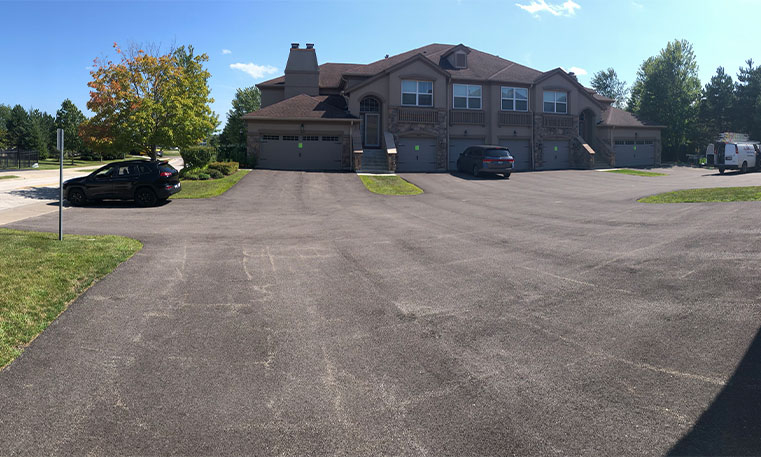 driveway before asphalt replacement