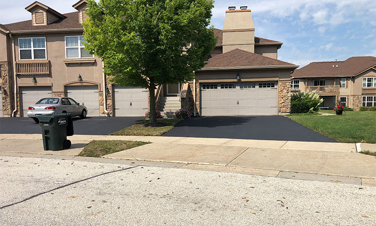 home driveway after asphalt replacement