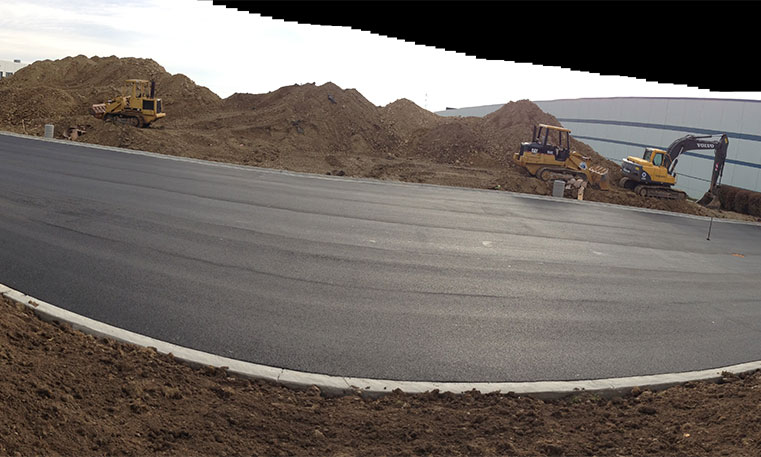 finished asphalt parking lot at construction site