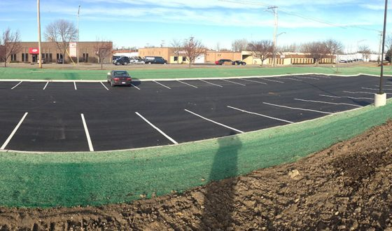 finished asphalt parking lot with green space