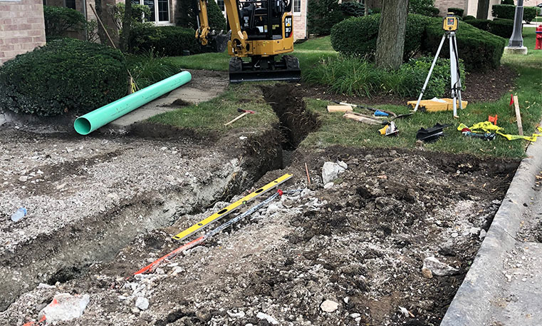 driveway concrete undergoing removal and replacement