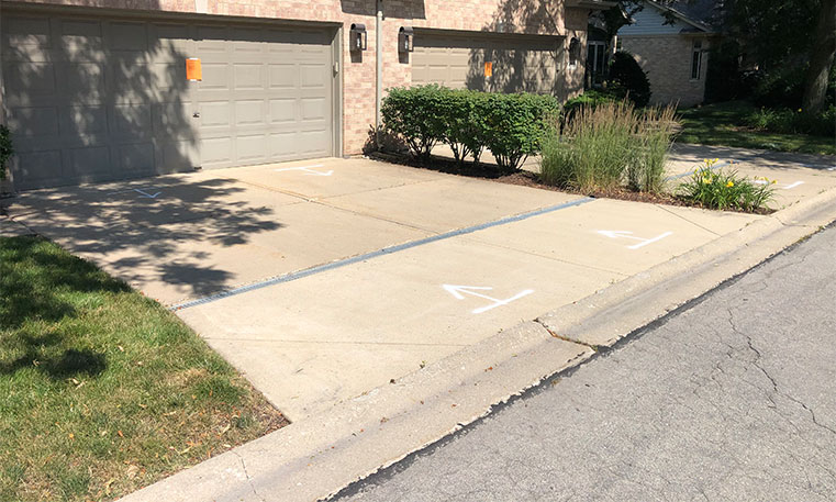 driveway of home before concrete replacement