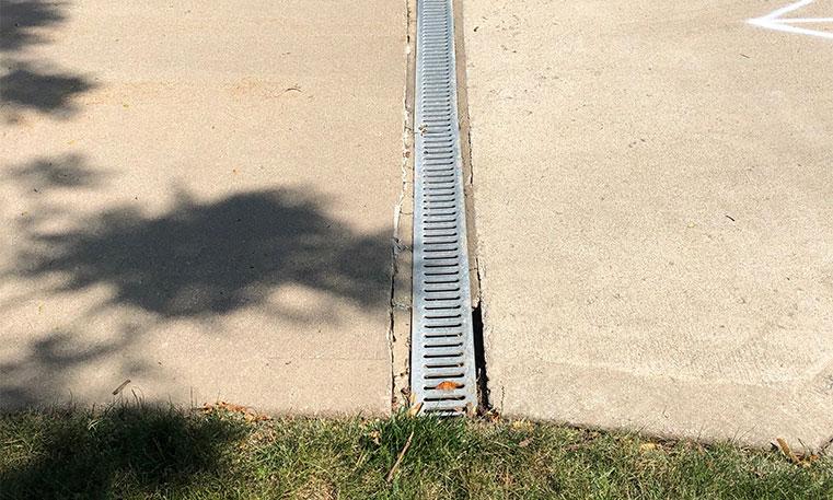 drain on damaged concrete