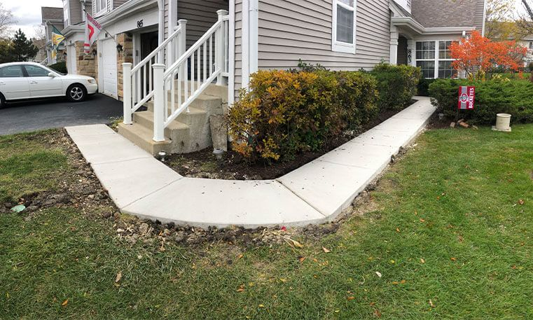 renovated sidewalk wrapping around home