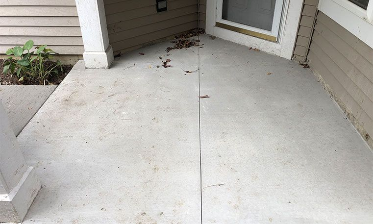 walkway of home with new concrete surface