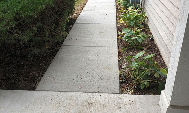 updated sidewalk concrete in front of home