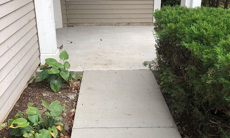 new concrete sidewalk in front of home