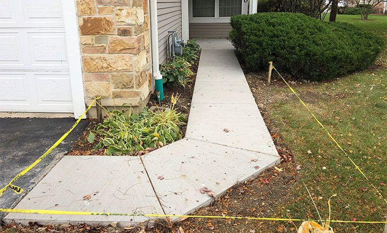 concrete sidewalk wrapping around home