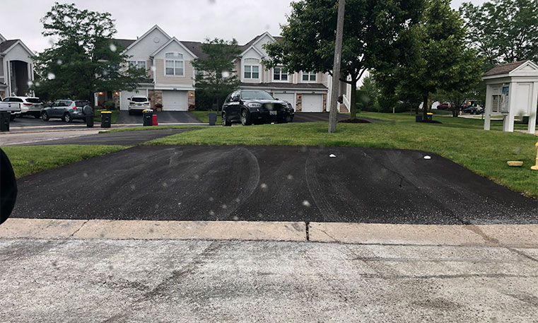 completed asphalt driveway in front of home