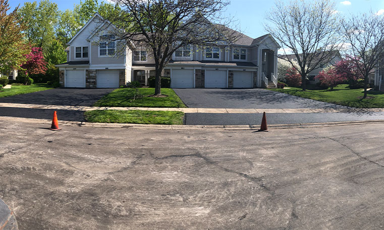 street view of condo unit with completed driveway