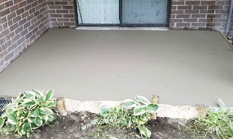 new patio concrete in front of home