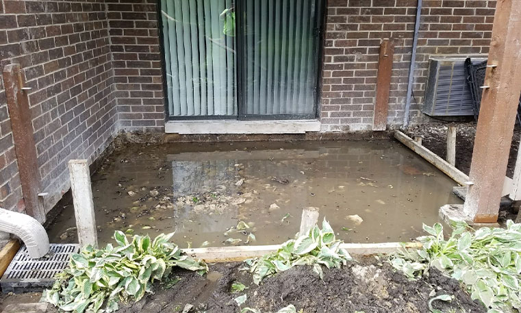 damaged patio concrete in front of home