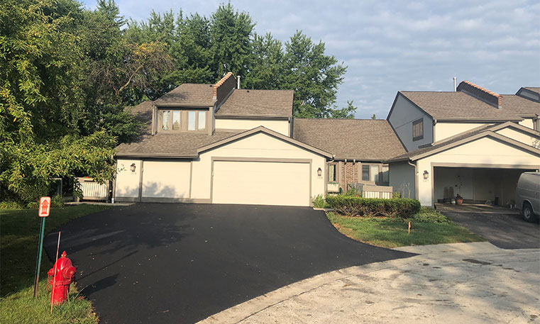 asphalt driveway after replacement