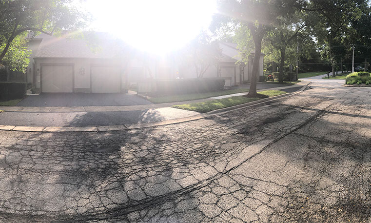 damaged driveway prior to removal and replacement