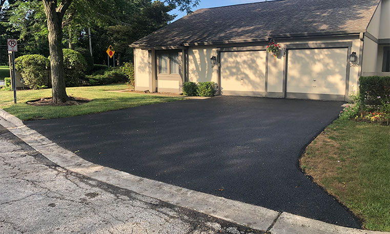 finished asphalt driveway after replacement