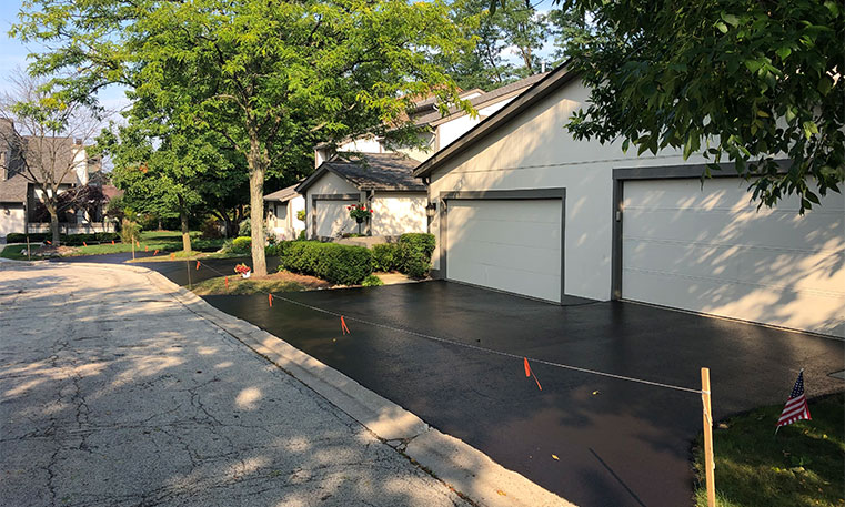 side view of finished driveway after asphalt replacement