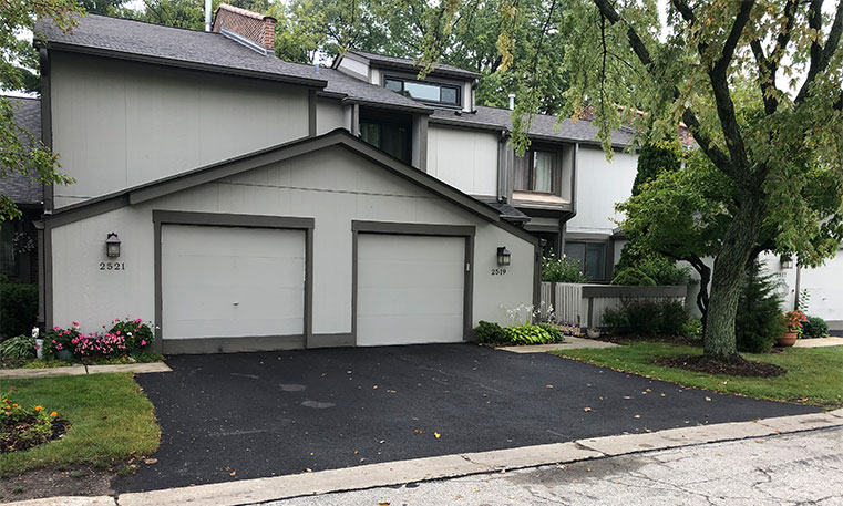 front view of home and driveway after asphalt replacement