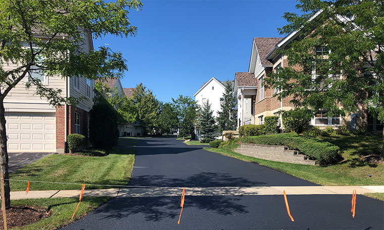 townhome street and driveways after asphalt replacement