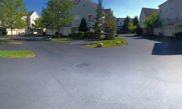 finished asphalt driveway and street at townhome assocation