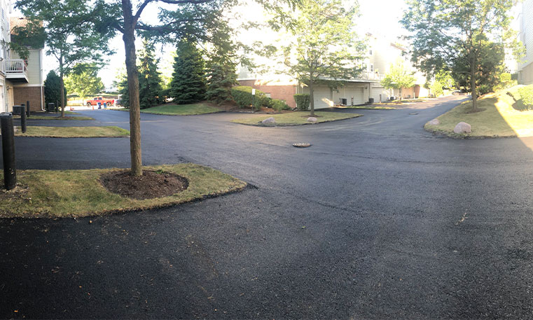 townhome driveway and parking space after asphalt replacement