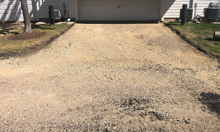 townhome driveway before asphalt replacement