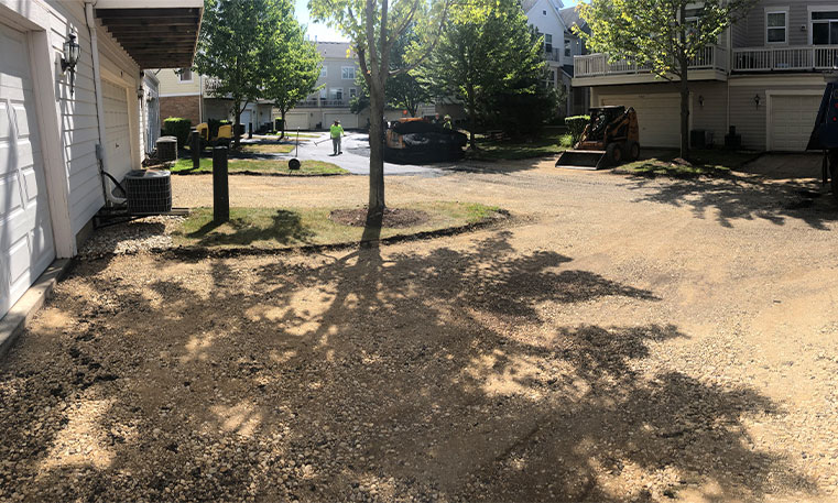 townhome driveway prior to asphalt replacement