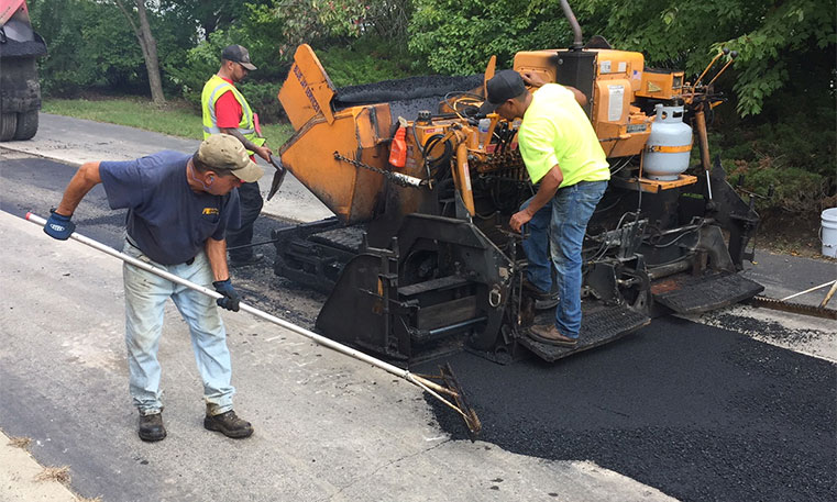 twin bros. team asphalt patching a damaged concrete surface
