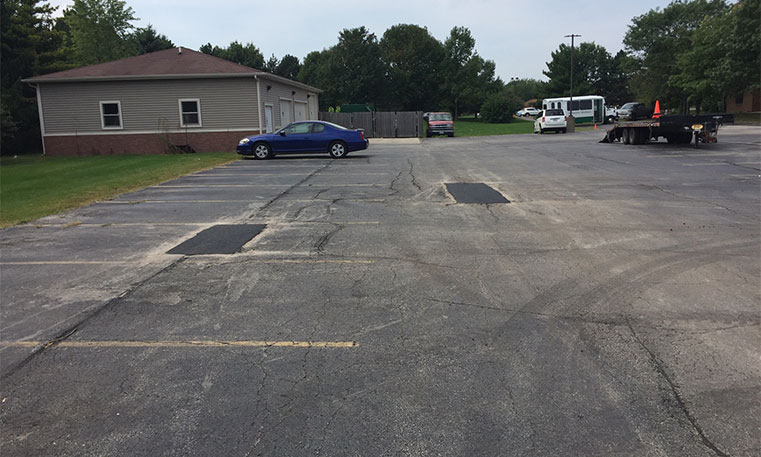 damaged parking lot pavement
