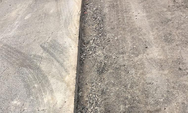 damaged concrete in parking lot