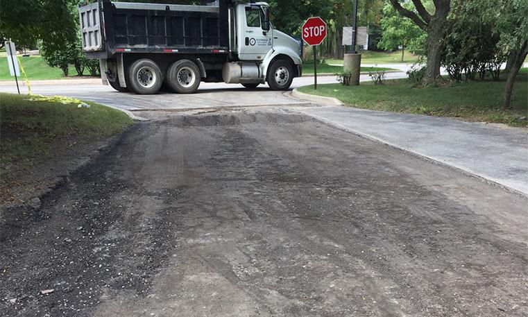 damaged parking lot surface