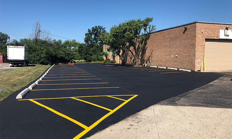 finished asphalt parking lot with lot markings