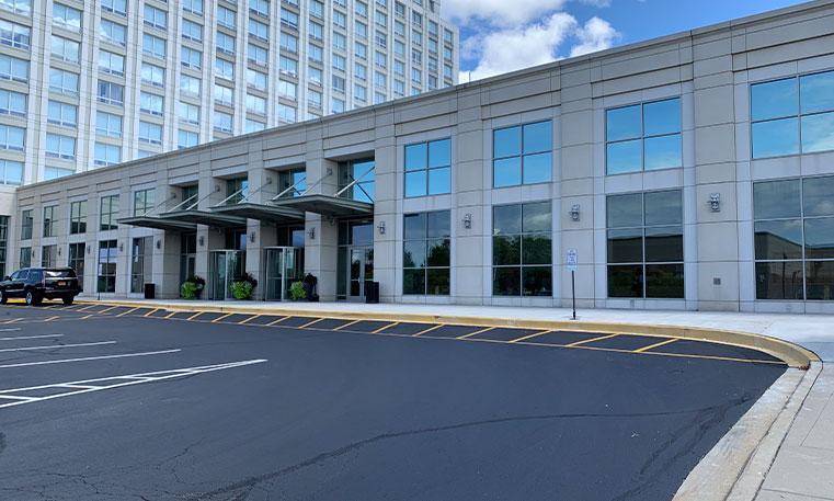 asphalt parking lot in front of the westin hotel