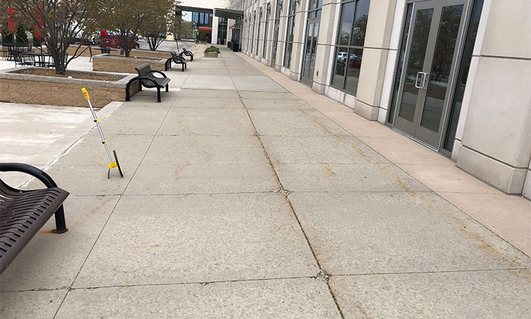 damaged sidewalk in front of the westin hotel