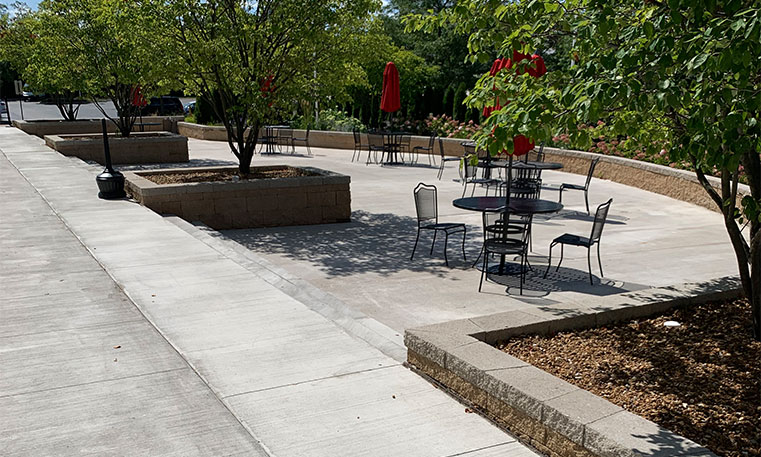 finished concrete and walkway in outdoor lounge area